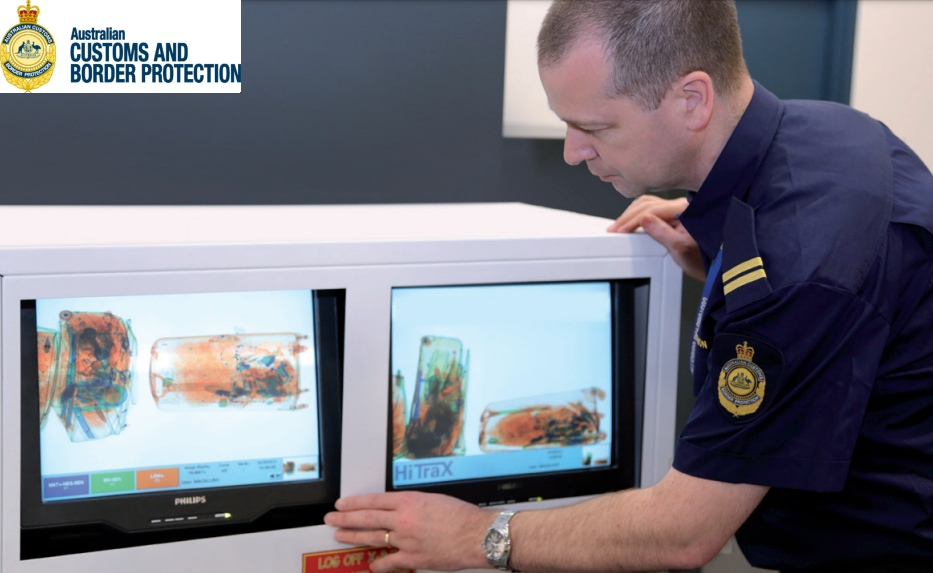 Australian Customs and Borders Officer viewing x-ray monitor