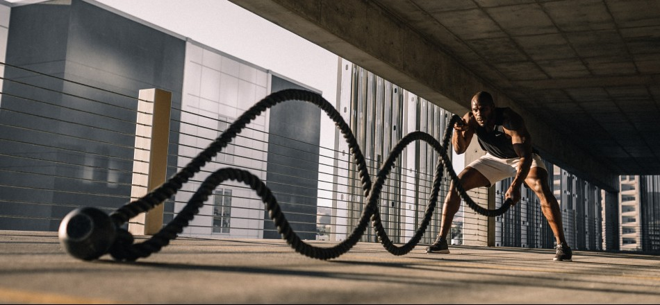 Black man working out with rope in an empty parking lot   Modafinil experience