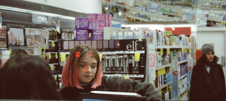 Student girl with pink hair buying Modafinil from pharmacy