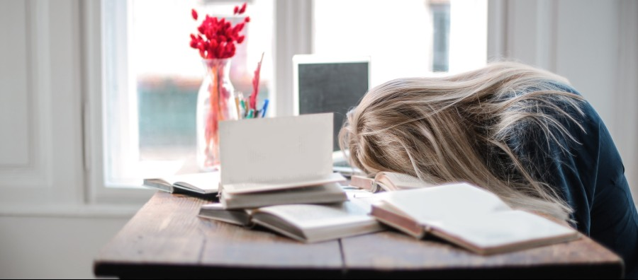 Girl fallen asleep on books while studying | Life without modafinil and coffee