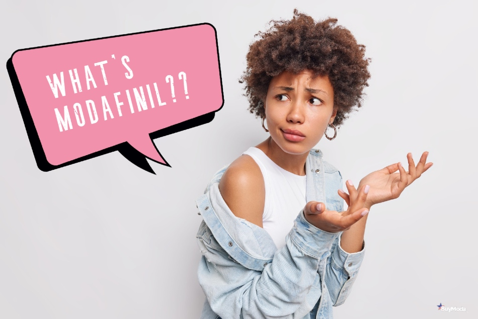 Woman with curly hair has hands raised and puzzled look asking what's modafinil